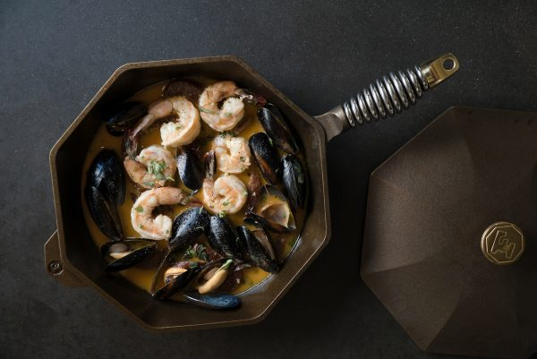 FINEX 12 inch skillet with lid and Olympia Provisions Recipe - Shrimp & Mussel Stew with Chorizo Navarre