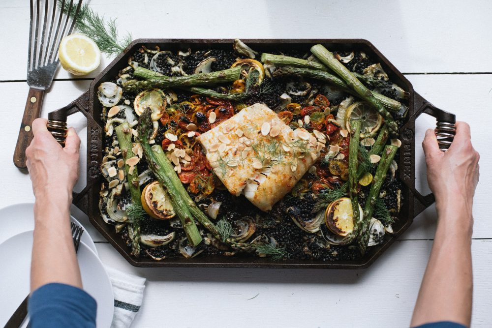 FINEX Griddle Pepper Jelly Halibut with Crispy Beluga Lentils, Asparagus and Tomatoes