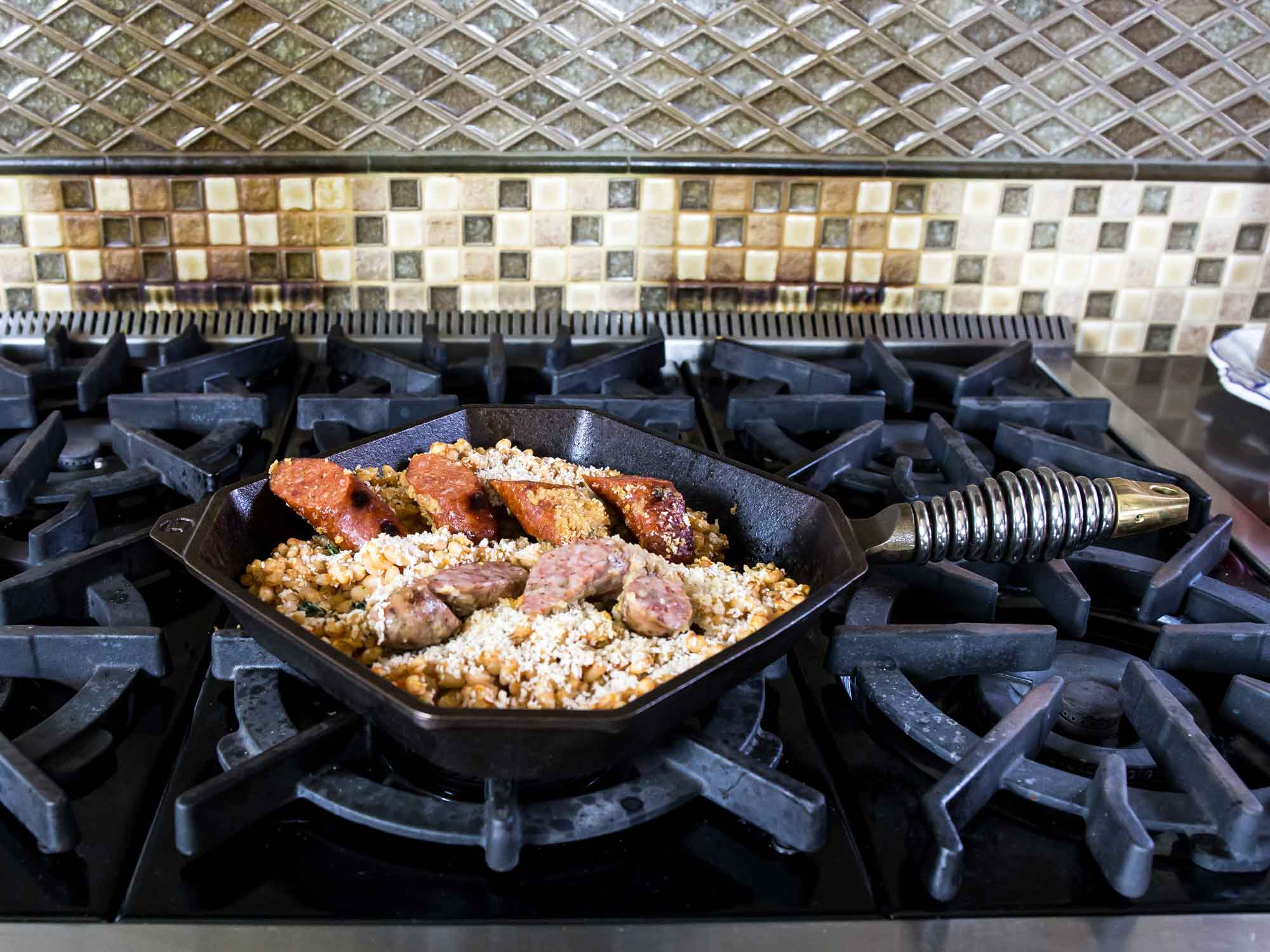 """10"""" cast iron grill pan with sausage on stove"""