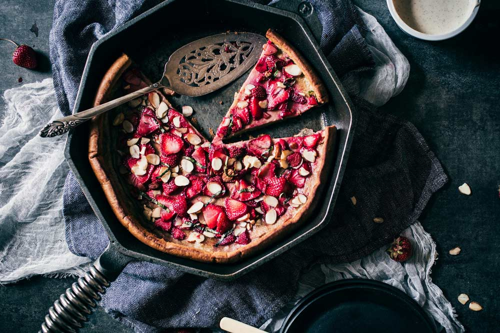 "strawberry gingerbread dutch baby in a FINEX 12"" skillet"