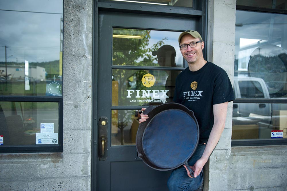 Mike Whitehead holding world's largest cast iron skillet